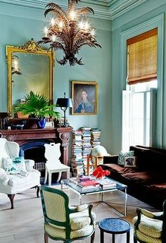 Eclectic turquoise Victorian living room by Sarah Ruffin Costello.
