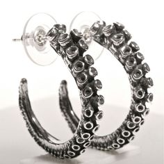 These beautiful octopus tentacle hoop earrings are amazing. They are made from the real octopus tentacle just like my very popular octopus tentacle ring. These hoops are small size measuring around 1'