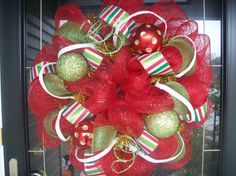 Deco mesh wreath: made it 'cause my mom taught me how.  They are SO easy, and totally customizable!  Success!
