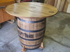 """Office folks went together and bought a barrel of whiskey. Also bought the barrel. In order to have a Friday gathering spot I thought we could make the barrel into a bar height table. Used qtr sawn white oak for the top and had office """"coin"""" la. Wine Barrel Table Diy, Whiskey Barrel Table, Wine Barrel Bar, Whiskey Barrels, Diy Patio, Patio Table, Wine Cask, Game Room Bar, Barrel Projects"""