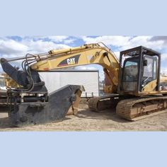 Caterpillar Excavator.  Year: 2003.  Model: 315CL.  Hours: 5,700+.     Equipped with:  DS2000P Vibra-Ram metal shear.  15 in. opening on shear.   Undercarriage: 90%. 28 in...