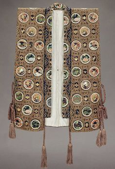 Man's vest, 19th century, Japan. .Man's dark blue silk Kabuki theater vest (jimbaori) with a rolled, turned down collar extending to the lower front edge and silk tie cords with tassels at the sides and front. This vest is for the role of a general at court. MFA. (William Sturgis Bigelow Collection)