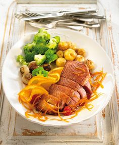 Orange duck with broccoli and baby potatoes