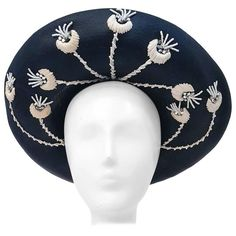 80s Jack McConell Black Straw Hat w/ White Flowers | From a collection of rare vintage hats at https://www.1stdibs.com/fashion/accessories/hats/