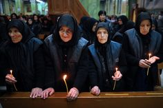Catholic women attend an Easter vigil mass in the Cathedral of Saint Michael the Archangel in the town of Rakovski on April 7, 2012. (Dimitar Dilkoff/AFP/Getty Images)