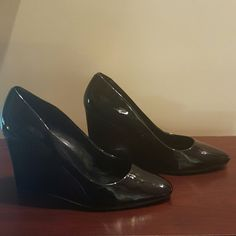 Ralph Lauren Black Patent Wedge Black patent leather Ralph Lauren wedges. Staple item for your wardrobe. Great multi-purpose shoes. Lightly worn. Size 9B Ralph Lauren Shoes Wedges