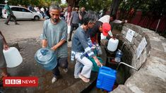 Cape Town water crisis: 'My wife doesn't shower any more' - Cape Town residents filling up water tanks at a mountain spring point, with a long queue behind International News, Water Tank, Bbc News, Cape Town, Shower, World, City, Taps, Zero