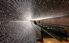 Visitors to the US National Gallery of Art in Washington, DC pass between the East and West Buildings via Multiverse, a light sculpture created by American artist Leo Villareal featuring approximately 41,000 computer-programmed LED nodesPicture: REUTERS/Kevin Lamarque