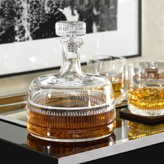 This retro decanter is crafted from gleaming handblown lead crystal and accented with vertical grooves that give it an Art Deco-inspired look.