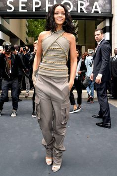 Rihanna pairs Balmain trousers with a fitted top for a sporty yet elegant look. Click here for more summer style tips.