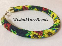 "Necklace ""Sunflowers on black"" by MishaMurrBeads on Etsy"