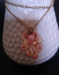 Handmade pink pearl and white octopus on a shell.The shell is