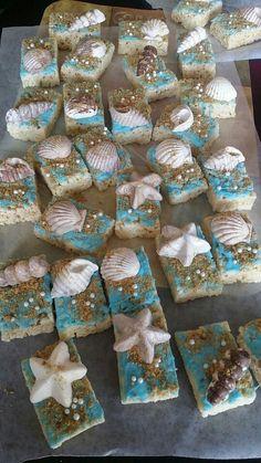 Beach theme treats!   Chocolate seashells with crushed Graham crackers on rice Krispy.