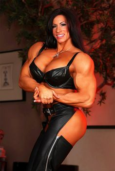Huge Muscle Girl Angie Salvagno posing and flexing her massive muscles.