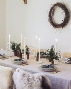 I recently shared my tips for simple Christmas entertaining and table styling for . Scandinavian inspired Christmas table setting with white candle sticks, linen table cloth and sheep skins on the chairs for added warmth Hygge Christmas, Merry Little Christmas, Noel Christmas, Scandinavian Christmas, Simple Christmas, Winter Christmas, Christmas Wallpaper, Rustic Christmas, Christmas Wreaths