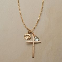 SKYLINE CROSS NECKLACE--A blue topaz and textured sun charm imbues our cross with heavenly symbolism. 14kt gold filled $118
