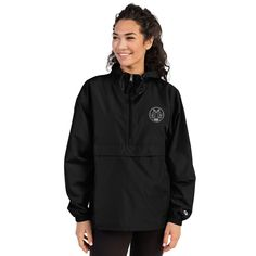 This wind and rain resistant polyester jacket with a detailed embroidery design has a practical hood, front kangaroo pocket, and zipped pouch pocket which you can pull out and use to scrunch the jacket into for convenient storage. Champion Jacket, Packable Jacket, Half Zip Pullover, Jacket Brands, Black And Navy, Rain Jacket, Windbreaker, Jackets For Women, Trending Outfits