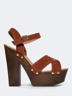 - No one can top your fashion-forward power when you strut in with these wooden platform heels! - Ankle strap sandals have a vegan suede upper with studded details and a buckle closure on the side giv