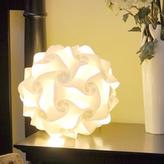 Lantern White 120 Piece Set now featured on Fab. This lantern (which can also be hung) is built like a puzzle, with 120 pieces in this set, that can be rebuilt into tons of different shapes. Instructions included. What's cooler?