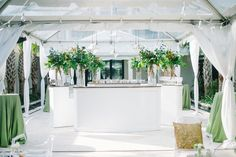 White wood bar with tall greenery and clear top tent with white draping, white and green wedding decor - thank you Event Haus and Sperry Tents! And isn't Cannon Green just breath taking. Event Design and Coordination: Mac & B. Events macandbevents.com Photography: Aaron and Jillian Photography aaronandjillian.com
