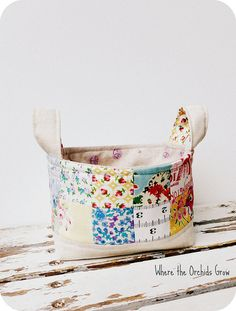 Fabric Bucket--the tutorial is actually over at Pink Penquin, it gives at first a not found error, but if you scroll down the side it's there, and the the pictures don't pin, but the process is there