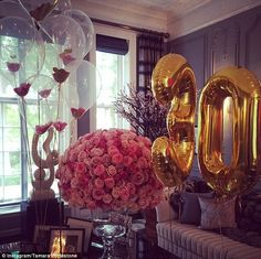 Tamara Ecclestone next to HUGE 30 made of pink flowers #dailymail