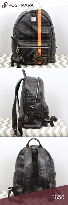 """🦁Authentic MCM Lion Stark Studded Medium Backpack 100% Genuine Product MCM Worldwide Limited Edition 🦁 Munich Lion Stud Backpack Color black & orange Size Medium 16x14x6 Gender Unisex Mens / Womens Style mmk5svu11 bk  Condition: A- (great condition) Visetos Coated Canvas & Cowhide Leather  Black crown & studs on the top & side of the bag, and YKK hardware Large inside compartment fits 13"""" laptop w/ 2 multi-use pockets and 1 zippered pocket  COMES WITH OUR FREE HANDMADE MCM DOG MOTIF CHARM…"""