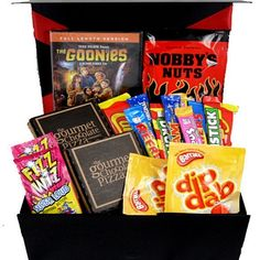 This 80s DVD and Treats to Share gift box hamper comes filled with a great 80s movie (7 to choose from) and great retro sweets, we have also included 2 chocolate pizzas and spicey nuts! This would make an ideal unique gift for any lover of 80s movies and is designed to share. Perfect for a fun night in together