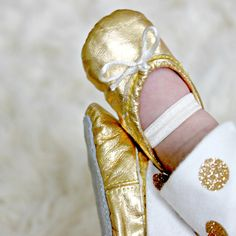 Gold Baby Ballet Slippers - comes in size 3-18 months. A darling shoe for baby as well as keepsake to hang in the nursery!