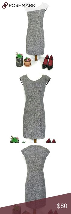 """The Limited Tweed Capped Sleeve Fitted Dress Stunning on! Perfect condition- worn once!   Size 0. 15.5"""" pit to pit, 13.5"""" flat across waist, 34"""" long. Has a very minimal amount if stretch.   Beautiful, classic and classy! Black and white (grey) tweed fitted dress with vneck and capped sleeves. Side zip with hook and loop closure. Slit at the back. Fully lined. This dress is a knockout! Tailored and elegant, wear to the office or on a casual date to a quiet bistro with pumps or stilettos! The…"""