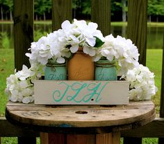 RUSTIC WEDDING CENTERPIECE, Yellow and Mint painted mason jars and planter is monogrammed. Beautiful for rustic or shabby chic wedding! by TheSouthernBlend on Etsy https://www.etsy.com/listing/244460527/rustic-wedding-centerpiece-yellow-and