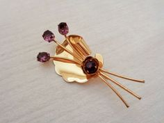 Exuberant and energetic, Coro's 1940s vintage spray brooch extols the virtues of more is better. The generously proportioned pin features large, loopy, lustrous  embellishe...