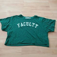 Crop top tee. Brand: urban outfitters x project social T x size: medium  (I'm a small) dark green. Letters made of felt, slightly faded off white. Worn a few times. Urban Outfitters Tops Crop Tops