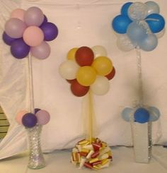 Great idea for party decor - tie balloons onto a broomstick that has been wrapped with ribbon and weighted by a pretty pot.
