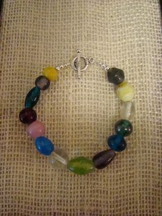 "6 1/2"" Colorful beaded bracelet on a silver toggle clasp. Free shipping!"