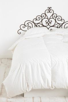 Filigree Headboard. Heavy-duty sculpted metal headboard in a filigree design. Fashioned with antiqued metal, giving your room a vintage charm.