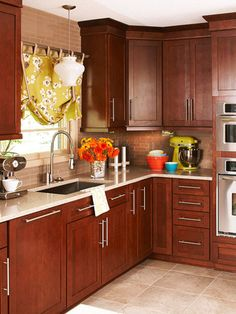 I love this dark cherry wood with the stainless steel appliances and hardware. It really makes everything pop