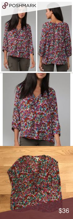"""Joie Silk Calabasas Magpie Floral Print Top This floral silk blouse features ruffles and a 3-button closure at the split neck. Inverted pleat at bust and ruching at neckline and cuffs. 2-button closure at cuffs. 3/4 raglan sleeves.  * 26"""" long, measured from shoulder. * Fabrication: Silk crepe. * 100% silk. * Dry clean. * Imported. Excellent condition. Joie Tops Blouses"""