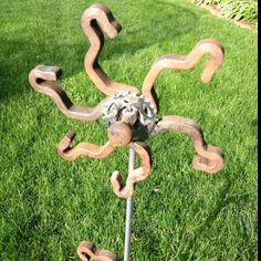Found art welded sculpture. Rr flower.
