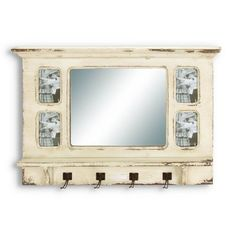 Find it at the Foundary - 34 in. Mirror with Coat Hooks and Frames $65.  Wood wall mirror with 4 photo frames 4 metal hooks  Distressed cream finish  Dimensions: 34W x 4D x 22H inches