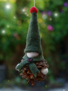 "<a href=""http://www.allfreechristmascrafts.com/Editors-Christmas-Craft-Picks/Pine-Cone-Crafts-for-Christmas"" target=""_blank"">Inspired by nature</a> and fantasy, this beyond adorable Felt and Pine Cone Gnome DIY Ornament will be the sweetest DIY ornament on your tree come Christmastime. This ornament uses a pine cone for the base and then felt pieces and balls for the rest. This little gnome is heartwarming and simple and needs to be hung on everyone's tree thi..."