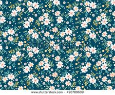 "Cute Floral pattern in the small flower. ""Ditsy print"". Motifs scattered random. Seamless vector texture. Elegant template for fashion prints. Printing with very small white flowers. Blue background."