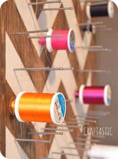 DIY #chevron #sewing #thread board for ample storage & great display. Store Thread with the bobbins. Use a piece of plywood and long finishing nails.