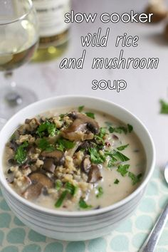 Slow cooker wild rice and mushroom soup - with garlic, parsley, cream, and white wine! This is DELICIOUS! And so easy too - just throw everything in the slow cooker for a simple but classy dinner!