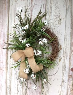 """Cotton Wreath for front door.Dimensions27""""x 17"""" and 6"""" DeepCreated on a 12 inch grapevine base.Hanger is attached, ready for hanging. This wreath will work insi"""