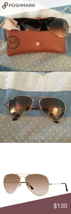 Ray Ban Gold Aviators Hardly worn gold Ray Ban aviator sunglasses. Includes cloth and glasses case pictured. Purchased at sunglasses hut. One small mark on frame in last picture. Ray-Ban Accessories Sunglasses