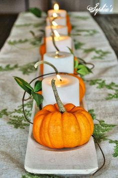 Pumpkins and Candles Tutorial: Mix and match pumpkins with candles to create an effortlessly rustic vignette.