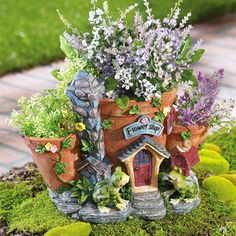Previous pinner: Fairie house in pots...great idea!...I'm thinking that by painting the pots with doors and windows I can make a fairy house with what I have!