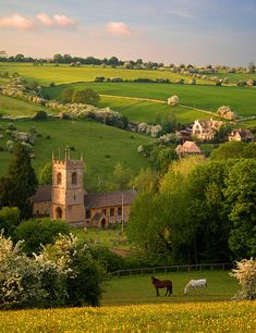 St. Andrews church in the cotswold village of Naunton, in the Windrush valley, Gloucestershire, England.