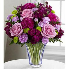 The Timeless Traditions Bouquet brings together #roses, stock and #carnations to create the perfect #flower bouquet for your special recipient.  Eye-catching lavender roses bloom brilliantly amongst fragrant purple stock, purple #carnations, lavender mini carnations and green button poms.